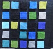 schwarzer Untergrund mit Vorfilzquadraten, jeweils doppel ausgelegt