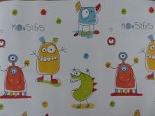 Das Geschenkpapier zeigt vier verschiedene Monster.